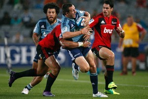Blues player Michael Hobbs (left) in action during last week's match against the Crusaders. Photo / Dean Purcell.