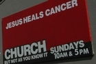 The new signage at Equippers church in Napier - which declares 'Jesus heals cancer' - may breach the advertising code. Photo / Paul Taylor