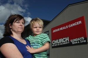 Jody Condin is far from impressed with the church sign. Her son Toby has leukaemia. Photo / APN