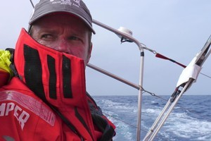 Skipper Chris Nicholson looks for out competitors on the horizon onboard. Photo / Volvo Ocean Race