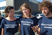 Lucy Lawless, centre, with Greenpeace activists outside New Plymouth's central police station, after their release on bail on charges relating to their 77-hour occupation of an oil ship. Photo /Greenpeace