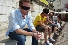 Taking a blind-folded tour of Lisbon. Photo / Robin Esrock