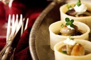 Roasted shallot and chevre tartlets. Photo / Babiche Martens