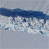A close-up image of the crack spreading across the ice shelf of Pine Island Glacier shows the details of the boulder-like blocks of ice that fell into the rift when it split. Photo / NASA