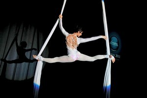 Eve Gordon performing acrobatics, suspended from silks. Photo / Supplied