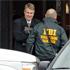 Investigators congregate at a rear entrance to Chardon High School in Chardon, Ohio. Photo / AP