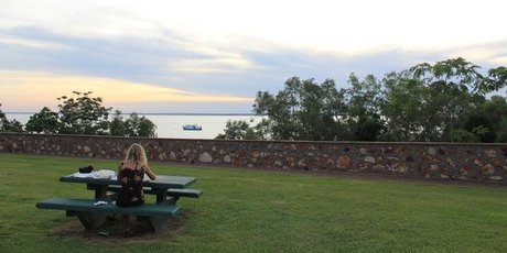 Eating fish and chips at Bicentennial Park in Darwin - one of the few cheaper ways of eating out in the city. Photo / Mauricio Olmedo-Perez 
