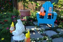 Gnonmified stars of the Christchurch Festival of Flowers - Gerry Brownlee (l) and Roger Sutton. Photo / Amanda Cropp