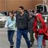 Parents take their children from Chgardon Middle School in Chardon, Ohio. Photo / AP