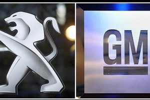 Pictures of the logo of French carmaker PSA Peugeot Citroen (left) and the logo of US giant carmaker General Motors. Photo / AFP