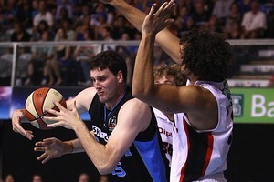 Matthew Knight of the Wildcats blocks Alex Pledger of the Breakers during the round 18. Photo / Getty Images