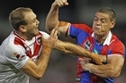 Jason Nightingale of the Dragons fights with Timana Tahu of the Knights. Photo / Getty Images