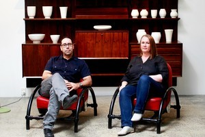 Tim and Natasha English sit in the Ron Arad Rover chairs. Behind their Crown Lynn collection is displayed on a Danish Poul Cadovius interchangeable cabinet. Photo / Steven McNicholl
