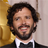 Bret McKenzie, center, poses with presenters Zach Galifianakis, left, and Will Ferrell and his award for best original song. Photo / AP
