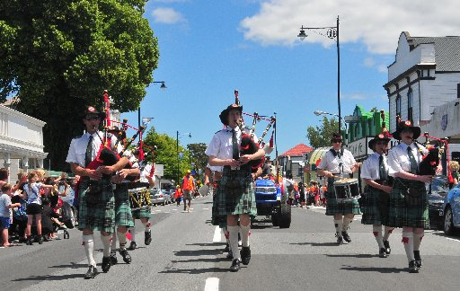 The Fern and Thistle Pipe Band on the march down the main street of Greytown for the Greytown Christmas Parade.