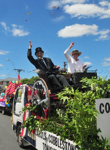 Graham Croton and Linda Kirkland throw lollies to the crowd from the Greytown Cobblestones float in the Greytown Christmas parade.