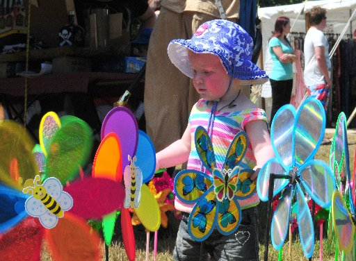 ALLURE: Windmills hold a special fascination for kids and adults alike and Jenene Handscomb,2, of Masterton is no exception. Pictured at the Travelling Gypsy Fair, Queen Elizabeth Park Masterton.