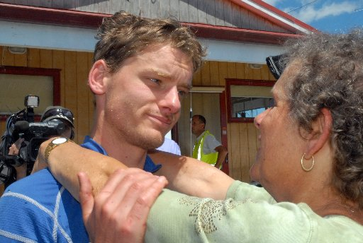 Wellington mountain runner Alastair Shelton hugs his mother Rachel McCahon at the LANDSAR base at Hood Aerodrome yesterday after spending two days lost in the cold and rainswept Tararua Ranges.