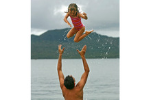 Dad's arms are the strongest in the world when you are 4 years old. Photo / Amos Chapple, Photo Researcher: Emma Land.