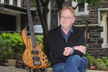 Dr Rob Burns says his rare five-string bass got him some great gigs, such as with Pink Floyd's David Gilmour and on TV shows. Photo / Otago Daily Times