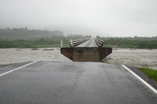 A central section of this bridge near Harihari on the West Coast was carried away by the storm-swollen Wanganui River. Photo / Hokitika Guardian