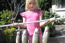 Jessica Knowles, 7 granddaughter of fishing guide Bryan Colman, with her catch. Photo / Supplied