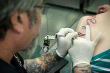 Auckland tattoo artist Steve Waugh says business often surges when a cruise ship is in port. Photo / Natalie Slade