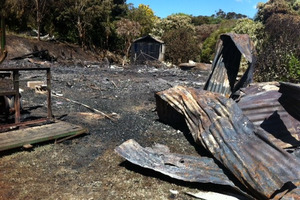 Aftermath of a fire that destroyed a property on Rakino Island. Photo / Supplied