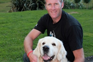 Mahe Drysdale with his golden retriever pal, Oslo, at his Cambridge home. Photo / Supplied