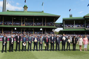 Players, commentators and family stand to mark the passing of Tony Greig. Photo / Getty Images
