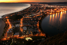 The spectacular view looking down over the main beach at Mt Maunganui at dawn. The Mount is one of the top summer holiday destinations in New Zealand. Photo / Alan Gibson