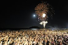 Thousands of revellers swarmed onto the beach at the Mount as the final countdown to 2013 began. Photo / George Novak 