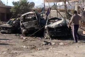 Another car bomb exploded (above) near Damascus in mid-December, killing over a dozen people. Photo / AP
