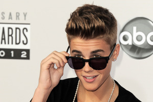 Police say a paparazzo was hit by a car and killed after taking photos of Justin Bieber. Photo / AP