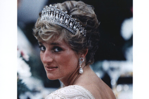 An undated photo of Princess Diana in a tiara and pearl drop earrings, attending a banquet for the Japanese Emperor. Photo / File
