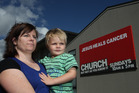 Jody Condin from Taradale - with cancer victim son Toby - was among those angered by Equippers Church claims on divine cancer cures. Photo / APN