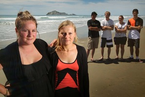 Laura Donovan (left) and Lynda Coldicutt, with their friends, pulled a collapsed, drunken man from the surf at Waimarama Beach. Photo / Warren Buckland