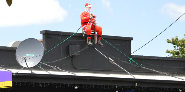 Santa is still missing from his perch atop Whangarei's Sabai Thai Restaurant after being stolen last week. Photo / John Stone