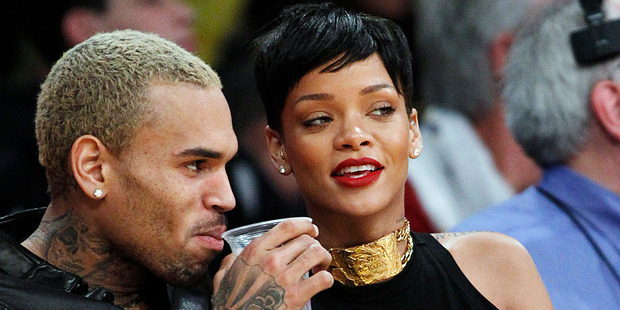 Chris Brown and Rihanna at a Los Angeles Lakers game. Photo/AP