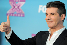 Simon Cowell's fortune has grown after the launch of The X-Factor USA. Photo/AP