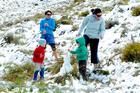 People dodging snowballs on the Crown Range yesterday. Photo / Linda Robertson