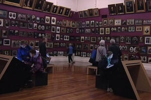 Visitors at the Smith portrait gallery at the Toitu Otago Settlers Museum. Photo / Supplied