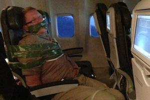 The man was bound and gagged with duct-tape by fellow passenger. The photo taken by a passenger was posted to Andy Ellwood's Tumblr account. Photo / Supplied