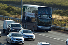 Auckland Transport's new double decker bus makes a run on the Northern Motorway in Auckland. Photo / Brett Phibbs