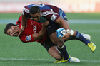 Francis Saili of the Blues fends off Dan Carter of the Crusaders.  Photo / Getty Images