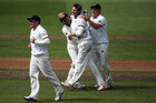Bruce Martin celebrates his first test wicket of Matt Prior of England with BJ Watling and Neil Wagner of New Zealand during day two. Photo / Getty Images