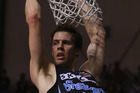Tom Abercrombie of the Breakers hangs on the hoop. Photo / Getty Images