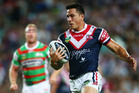 Sonny Bill Williams of the Roosters heads for the try line to score. Photo / Getty Images