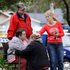 Family members console each other near the home where Jeff Bush disappeared as a large sinkhole opened under the bedroom of his house. Photo / AP