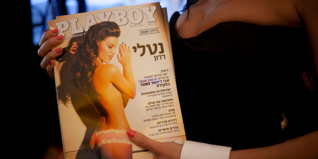 A model dressed as a Playboy bunny poses with the first Hebrew language edition of popular men's magazine Playboy in Israel. Photo / AP